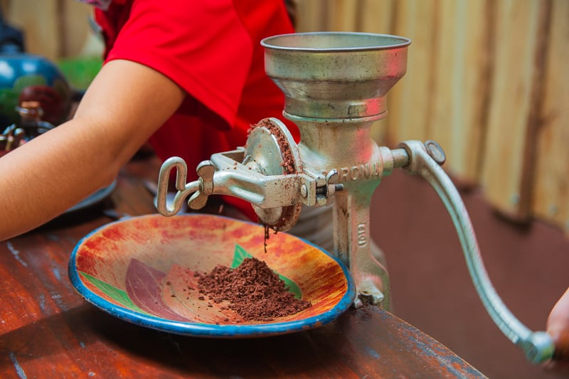 grinding coffee beans in machine